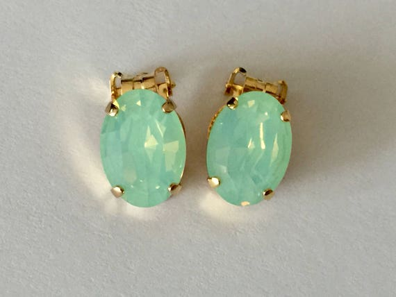 Oval Chrysolite Opal Swarovski Crystal Clip On Earrings, Yellow Gold