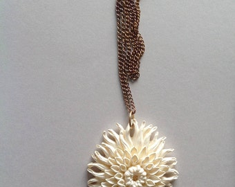 Molded plastic flower pendant on chain. 1950s.  Similar to celluloid. XL.  Plus size.