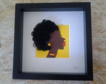 table quilling depicting the face of an African woman