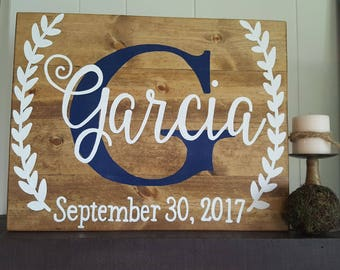 Custom Last Name - with date- laurel wreaths -wood sign - wedding sign - anniversary sign