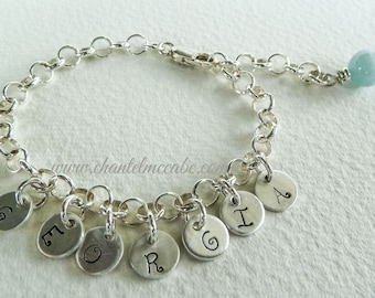 Personalised name bracelet in sterling silver with 7 charms and a gemstone bead dangle, adjustable length, Perth Western Australia
