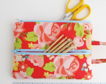 Double Zip Tool Bag | Red floral fabric pouch with two zippered compartments and a hanging loop.