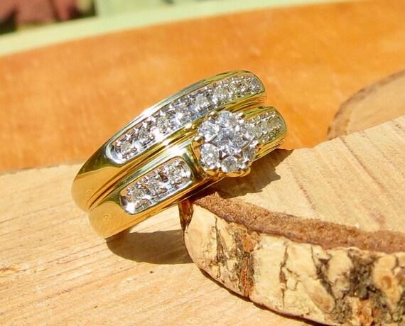 A set of 9k yellow gold diamond rings.