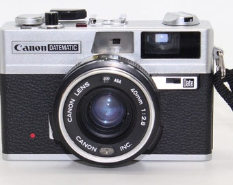 Canon Datematic Compact 35mm Film Rangefinder Camera with case, flash, manual and new batteries – c.1974 – Tested and working