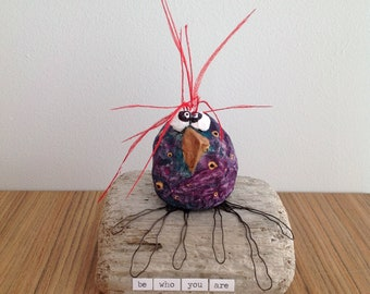 Papier mache bird sculpture