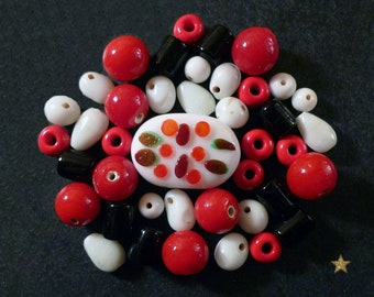 Silver handcrafted Indian, white, red, black with various shapes