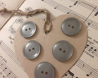5 large grey buttons