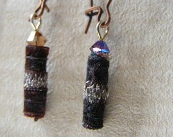 Earrings Like a cat with two eye colors. Unique and beautiful. Dark Brown and silver.