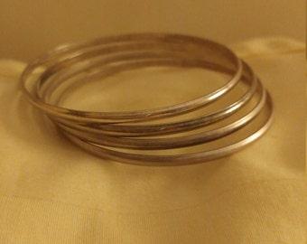 Vintage Set Of 4 Silvertone Metal Bangle Bracelets