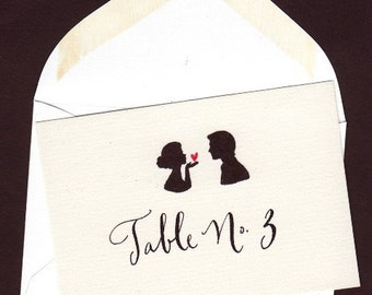 Escort cards and table number envelopes and calligraphy for wedding