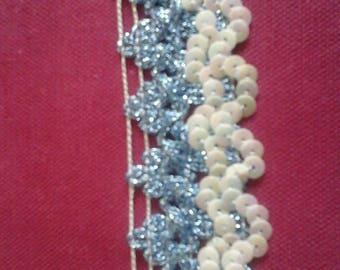 Pretty blue stripe Lurex decorated with iridescent white glitter the meter