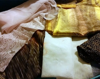 One pound of assorted fabrics and trims for doll costuming or crafts - color coordinated goodie bag to get your imagination going...