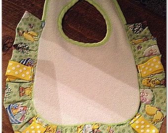 Green and yellow gender neutral Easter bib.  Make sure your baby has a stylish bib for any Easter gatherings.