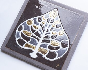 Bottom of leaf dish stylized glazed lava and touches of gold