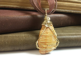 Gold toned Wire Wrapped Striped Shell