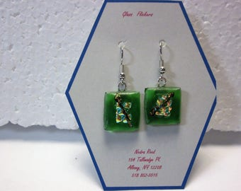 "Fused glass earrings: green glass with clear textured dichroic and green ""pulled"" dichroic"