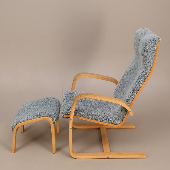 Scandinavian Yngve Ekström style bent plywood armchair and stool with sheepskin lamino cover