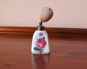 Vintage perfume bottle with spray dispenser.