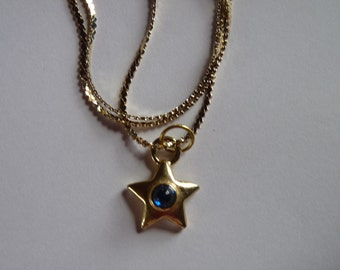Gold Star with blue bead