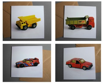 Set of four toy vehicle greetings cards