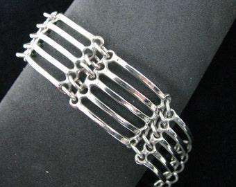 Silver tone industrial look lined link bracelet