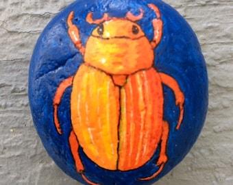 Scarab beetle painted rock