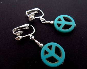 A pair of cute little hand made tibetan silver & turquoise peace sign dangly clip on earrings. new.