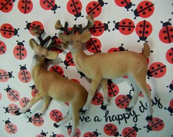 two adorable plastic deer figurines