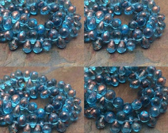6x4mm Czech Glass Drops beads. One unit has 50 beads. Blue Drops with Copper Splash