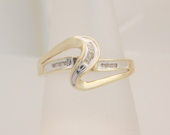 0.20 Carat T.W. Ladies Baguette & Round Cut Diamond Cluster Ring10K