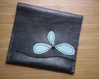 Hand stitched leather pouch with blue flower decoration