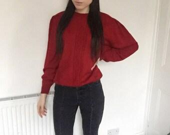 Red oversized grandad-style jumper