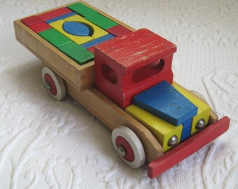 wood toy truck . wood truck . wooden truck with blocks . wood toy . heros wood truck . heros . heros wood toy . toy truck