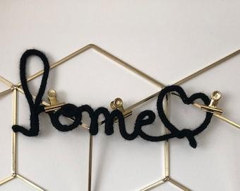 Home + black heart shaped knitting