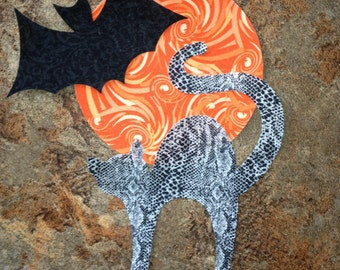 Die Cut Applique.  Set of 3,  Halloween Shapes, Gray Python Cat, Black Bat, Orange Swirl Full Moon. Left-facing. Fusible (Iron On).