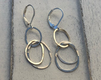 Sterling silver organically shaped hoops.