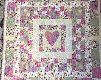 Pretty pink patchwork lap quilt