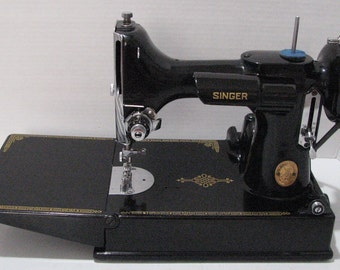 Beautiful Singer Featherweight 221 machine made in 1951 with original attachments , manual , buttonholer and bonus travel iron