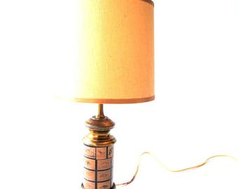 Mod vintage 50s small  brass, table  lamp with a light burlap shade.