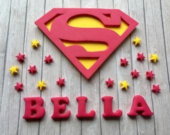 Large Edible fondant sugar personalised hot pink and yellow Superman / girl logo cake topper set - Supergirl party