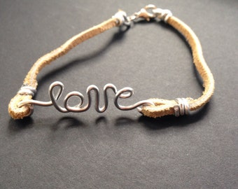 Wire wrapped leather bracelet with cursive love