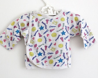 Vintage newborn cotton long-sleeve top with bright sports logo allover print, age 0-3 months