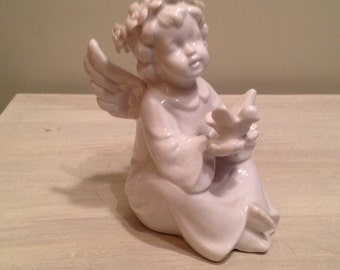 Little white Angel for a first communion or birth
