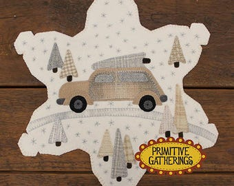 Wool Applique Tablemat pattern - Bringing Home the Tree by Primitive Gatherings 16 inch - Shaped Snowflake with Stitched snowflakes