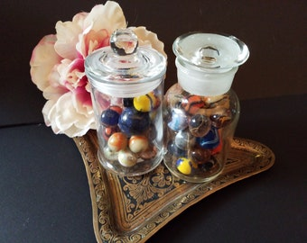 2 glass jars of marbles