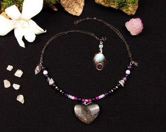 Necklace with a heart in Obsidian silver and Silver 925, natural feathers