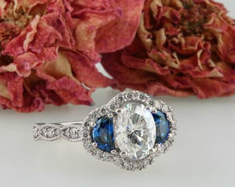 Oval Moissanite Forever One Brilliant Halo Blue Sapphire Engagement Ring  Antique Vintage style Ring. 14k White Gold 8/6.unique design .