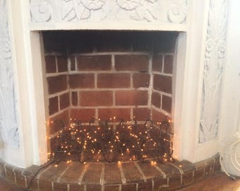 Year long faux fireplace logs with 8 setting multi light function twinkle lights