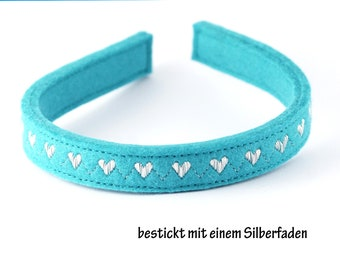 Headband made of wool felt embroidered with a shiny silver thread