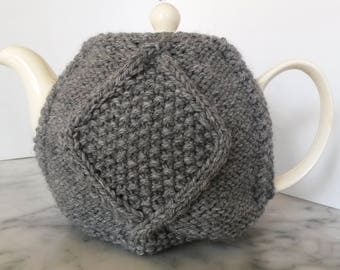 Knit teacozy: handknit Aran diamond tea cosy. Original design. Made in Ireland. Teacosy available in gray or blue. Great gift for new home.